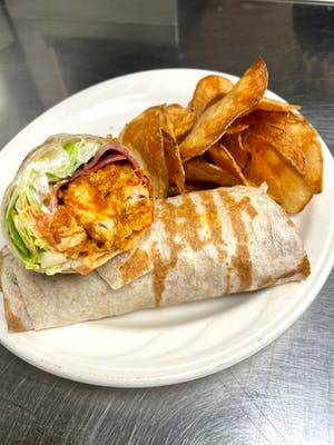 Buffalo Chicken Bacon Ranch Wrap - Cheddar cheese, spicy buffalo sauce, hint of spicy garlic, turkey bacon, lettuce, tomato, and ranch. Wrapped in a thin pita.